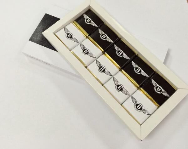 Сувенирная продукция <h6>Подарки, Фирменный шоколад</h6> <h6>Флажки</h6> <h6>Брелоки, Значки</h6>
